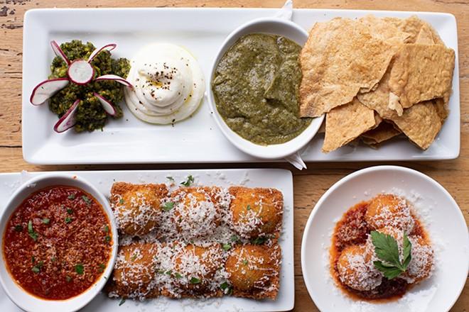 Pistachio pesto and charred zucchini dip, toasted ravioli and arancini. - MABEL SUEN