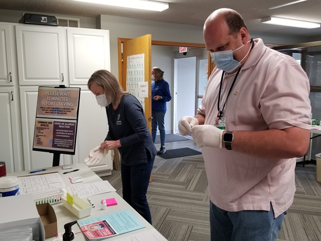 Nurse Anita Perry, left, and Curtis Lanning, emergency coordinator, process samples Friday during a drive-up COVID-19 testing event at the Livingston County Health Center in Chillicothe. - RUDI KELLER/MISSOURI INDEPENDENT
