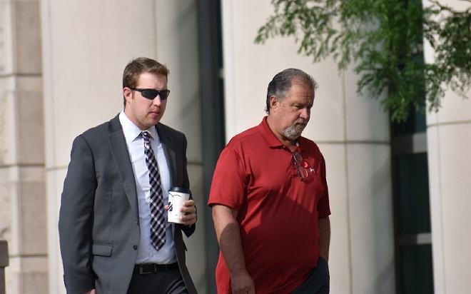 Ex-St. Louis police officer Chrisopher Myers (left) arrives at court on June 17. - DOYLE MURPHY