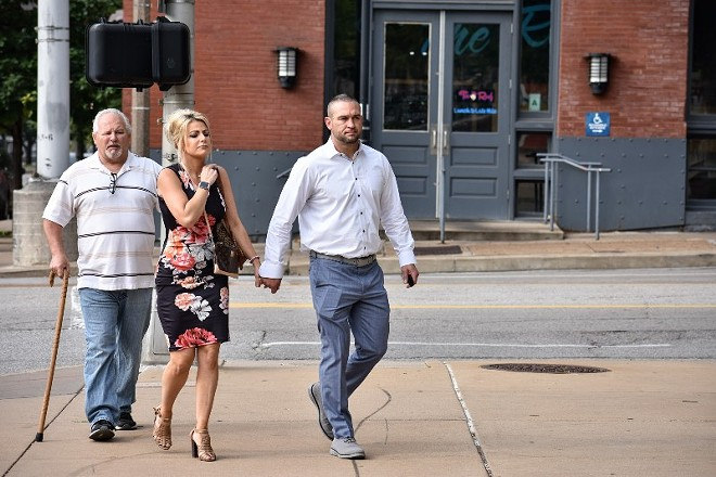 Ex-St. Louis police officer Dustin Boone walks to federal court on June 17 with his wife, Ashley Marie Boone. - DOYLE MURPHY