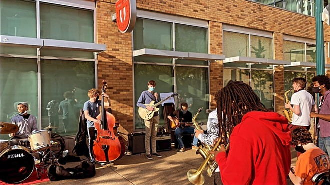 The Slums performing in the Delmar Loop. From left to right, Jared Spears (drums), Evan Wohlrabe (upright bass), Aidan Bartholet (guitar), Jack Morris (guitar). - KESHON DUKE