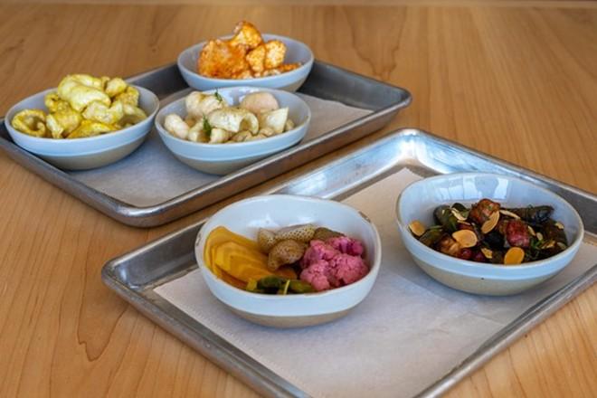 Side dishes include pork rinds, pickled vegetables and seasonal vegetables. - HOLDEN HINDES