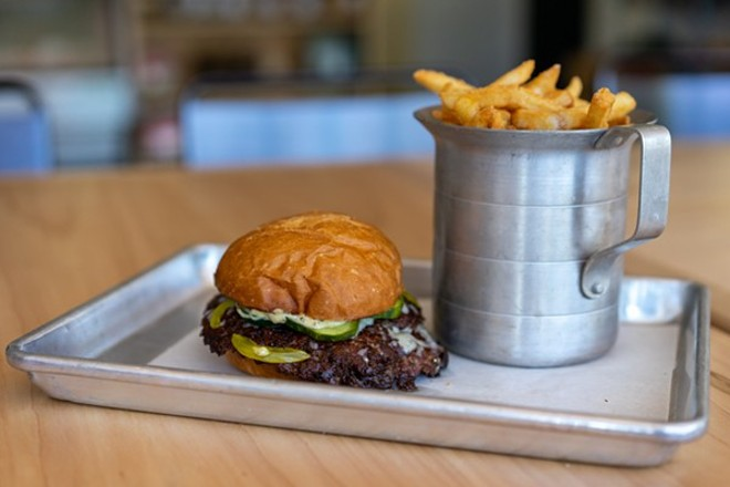 The Bolyard's burger with tallow fries. - HOLDEN HINDES