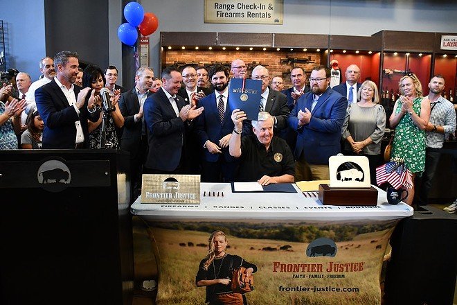 """Gov. Mike Parson celebrates the signing of Missouri's Second Amendment Preservation Act"""" at a gun range. - MISSOURI GOVERNOR'S OFFICE/FLICKR"""
