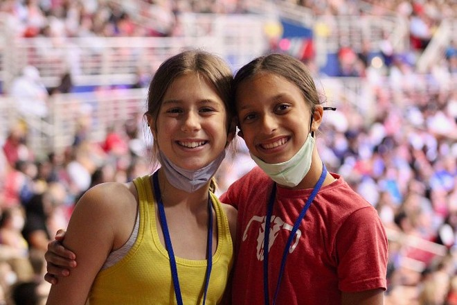 Gymnasts Elizabeth Ayers, left, and Lakshmi Coffey smile at Friday's trials after competing in their T&T gymnastics events earlier that day. - ZOE BUTLER