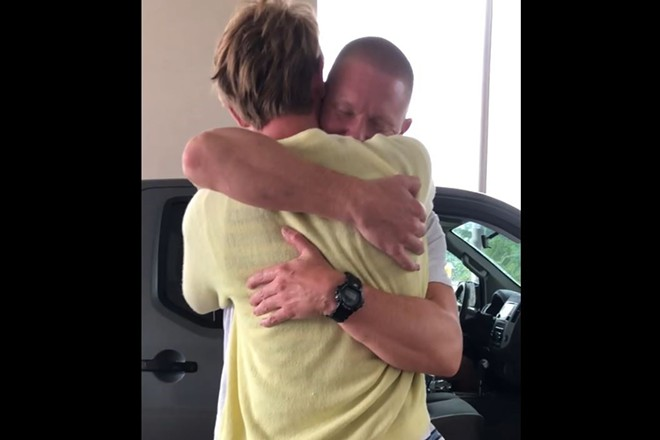 Eric McCauley hugs his son on after his release from federal prison. - COURTESY OF JESSICA ORTON