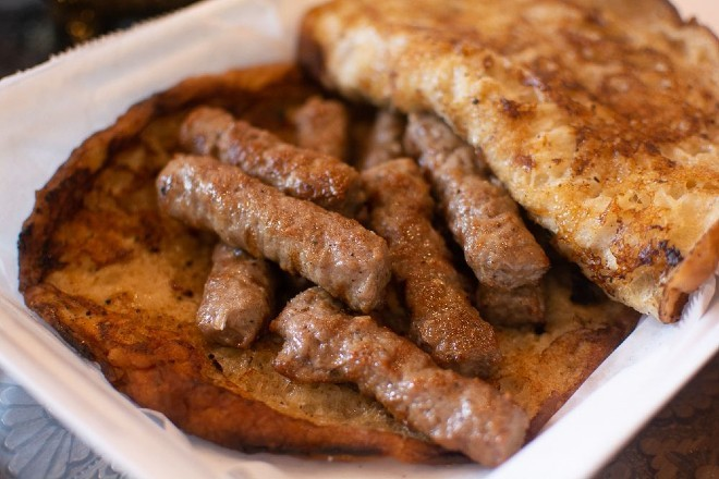 Cevapi, a traditional Bosnian dish, is one of Grbic's specialties. - ANDY PAULISSEN