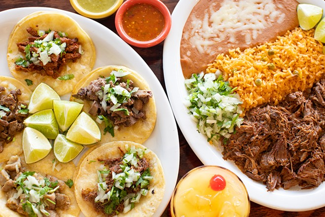 Al pastor (marinated pork), asada (steak), lengua (tongue), tripas (tripe) and barbacoa (shredded beef) tacos alongside barbacoa platillo. - MABEL SUEN
