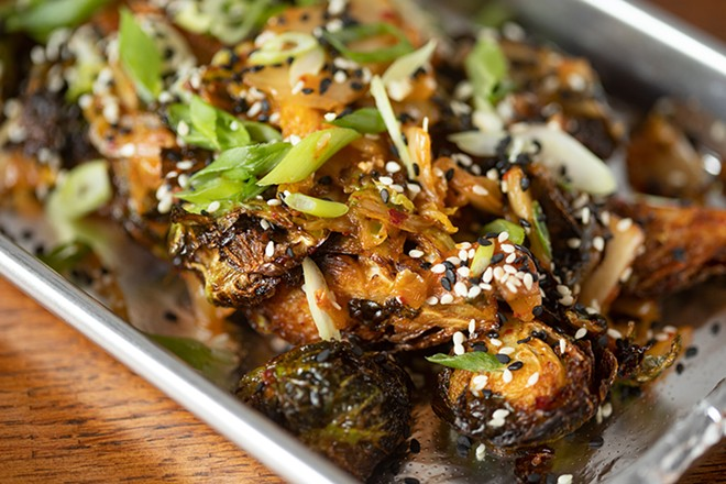 Kimchi brussels sprouts with fried sprouts, kimchi and toasted sesame. - MABEL SUEN