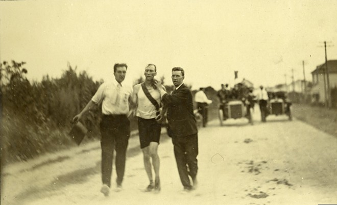 Thomas Hicks, one of the athletes in the 1904 Olympics, being supported by his trainers in the 24-mile marathon race. - COURTESY MISSOURI HISTORICAL SOCIETY