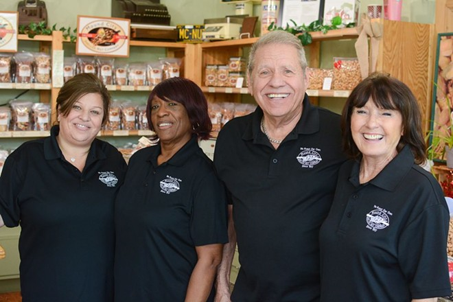 Byron Smyrniotis (third from left) with his crew at Mound City Shelled Nut Company. - ANDY PAULISSEN