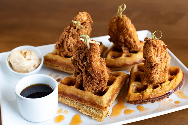 Chicken and waffles with buttermilk fried chicken, waffle, hot honey and cinnamon butter. - MABEL SUEN