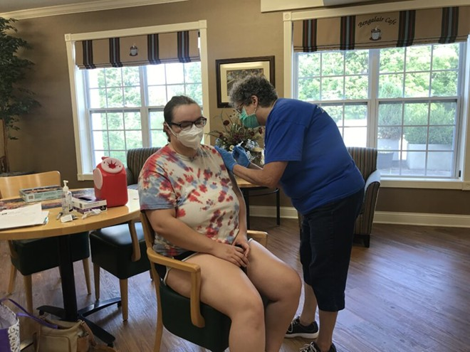 Regina Murdock, a registered nurse with D&H Drugstore, administers a dose of the Pfizer vaccine to Kali Lindsay, a dietary aide, on Aug. 6, 2021 at a clinic at the Neighborhoods by TigerPlace in Columbia, Missouri. - TESSA WEINBERG/MISSOURI INDEPENDENT