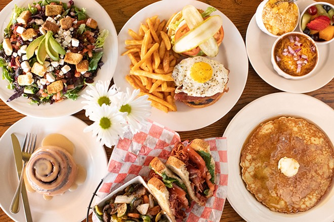 A selection of items from Have A Cow: Field Greens salad, The Whole Farm burger, sides, cinnamon roll, The Porker sandwich and pancakes. - MABEL SUEN