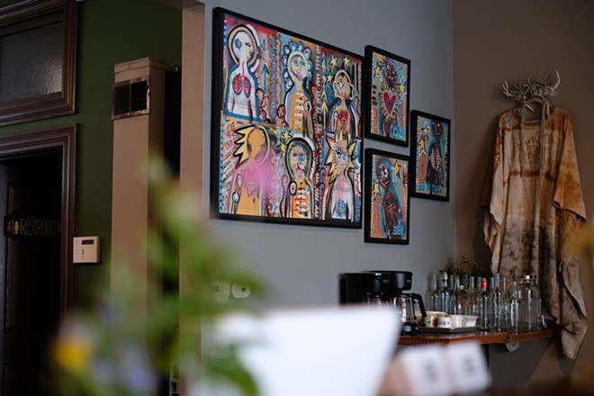 Colorful artwork decorates the space. - PUONG BUI