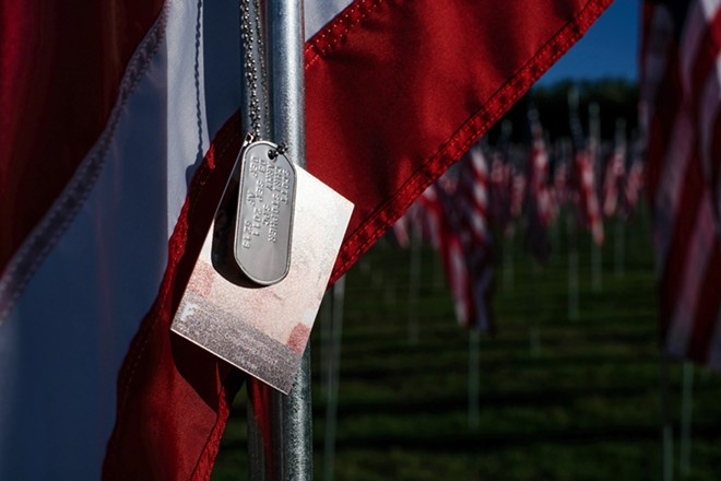 A photo and dog tags are affixed to each of the 7,500 flags. - PHUONG BUI