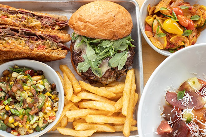 A selection of items from Bolyard's Meat & Provisions: Reuben sandwich, Umami Burger, seasonal veggies, succotash, tallow fries and the seasonal salad. - MABEL SUEN