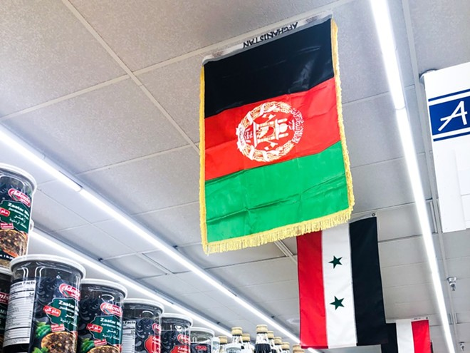 The Afghanistan flag in an aisle at Global Foods. - COURTESY GLOBAL FOODS