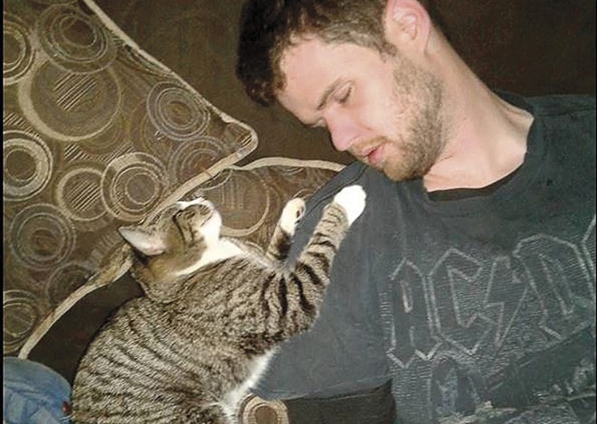 Malissa Ancona posted this picture of Paul Jinkerson Jr. and one of her cats the night before her husband's murder. - FACEBOOK