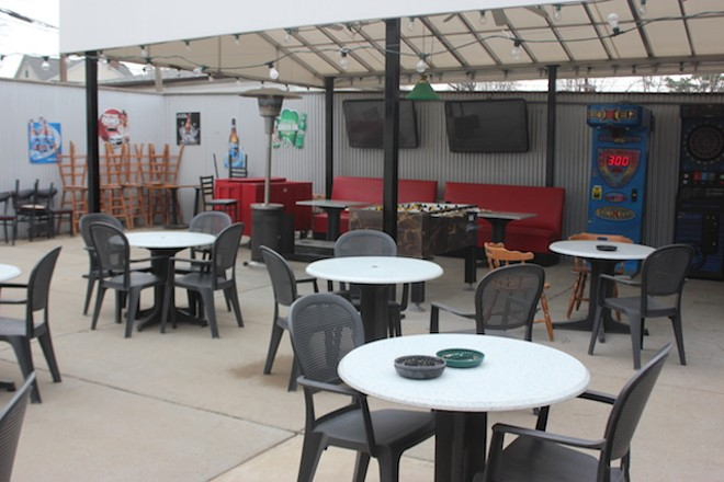 The patio features some classic arcade games, plus a foosball table. - PHOTO BY SARAH FENSKE