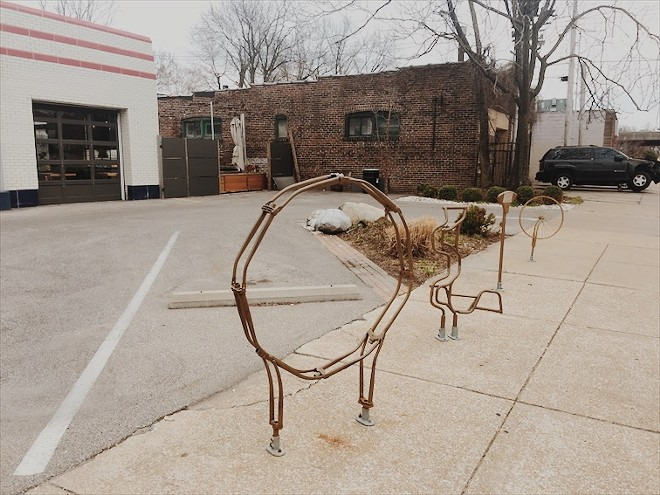 A deconstructed bike rack sits in front of Olio, the acclaimed Mediterranean-influenced restaurant in Shaw. - PHOTO BY KELLY GLUECK