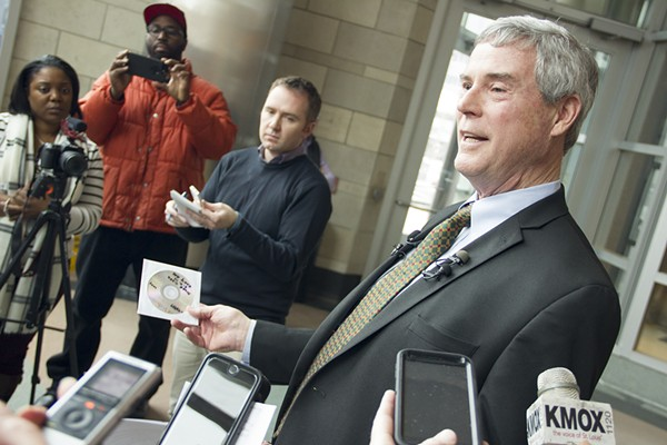 St. Louis County Prosecuting Attorney Bob McCulloch holds a CD containing surveillance footage from Ferguson Market on the day of Michael Brown's death. - PHOTO BY DANNY WICENTOWSKI