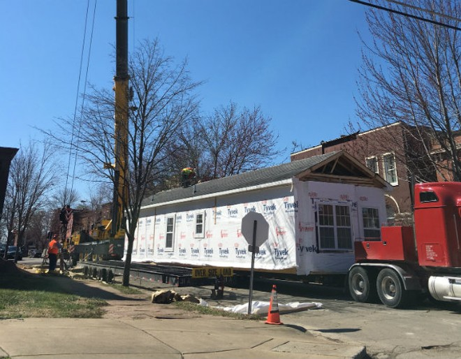 The second floor of a pre-fab home made its way through Tower Grove East on Thursday morning. - PHOTO BY THOMAS CRONE