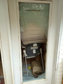 Police tweeted a picture of the Boyds' broken window after the shooting. - ST. LOUIS COUNTY POLICE/TWITTER