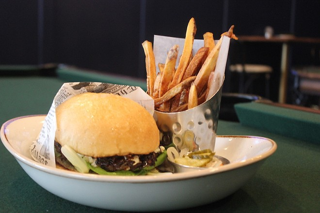 The house burger comes topped with boursin and carmelized onions. - PHOTO BY SARAH FENSKE