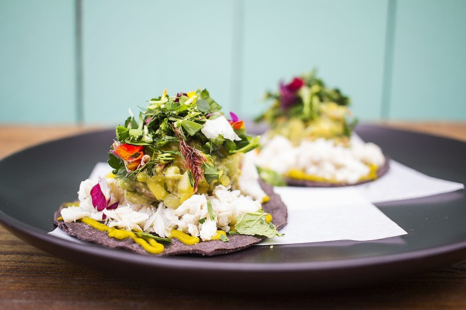 Crab tostadas with avocado, poblano and mango on blue-corn tortillas. - MABEL SUEN