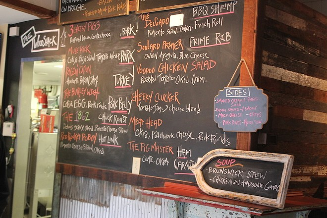 A chalkboard displays menu offerings. Customers order at the the counter. - PHOTO BY SARAH FENSKE