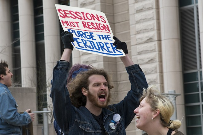 A protester in front of the federal courthouse had some choice words for Jeff Sessions. - PHOTO BY NICK SCHNELLE
