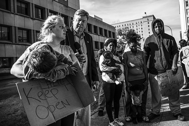 Homeless residents protested the attempted closure of Larry Rice's New Life Evangelical Center earlier this year. - PHOTO BY NICK SCHNELLE
