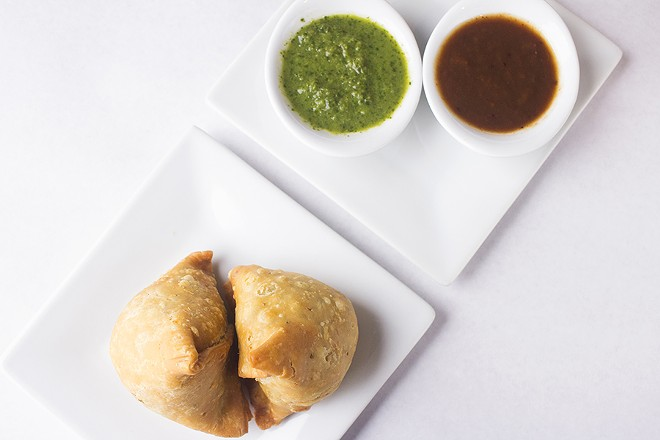 Samosas are filled with mildly spiced potatoes, peas, chick peas and dried fruits. - MABEL SUEN