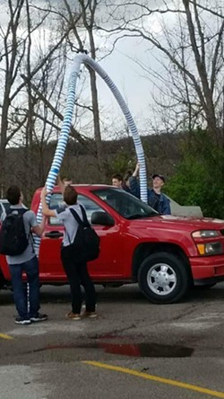 A truck drives through a Polar Pop archway in the parking lot of Hillsboro High School. - PHOTO PROVIDED BY NICK ARL
