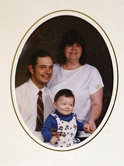 Kim Wells, right, with her young son and her husband before his murder. - COURTESY OF IAN BOYER