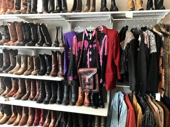 Cowboy boots on display at Found by the Pound. The shop opens April 22. - COURTESY OF RICK WOLF