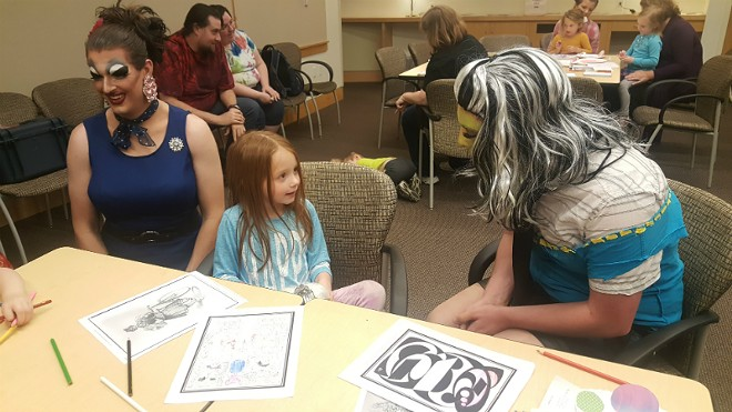 Five-year-old Olivia McArthy chats with local drag performers Celeste Covington (left) and Princess Hoodlum at Webster University. - ALLISON BABKA