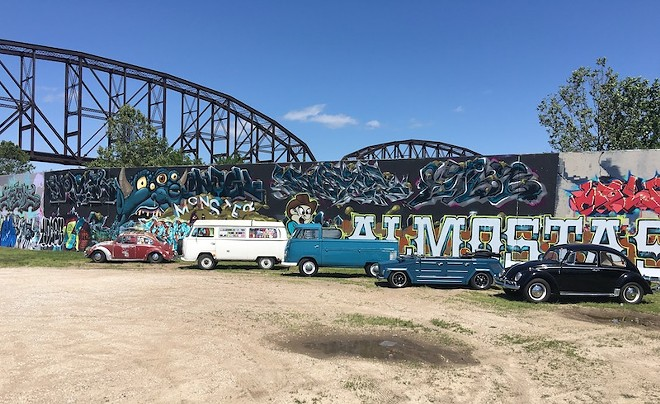 Vintage Volkswagen models gather near the Graffiti Wall in downtown St. Louis. - COURTESY OF AIR COOLED ANTIQUES