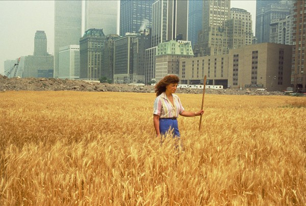 Agnes Denes, Wheatfield—A Confrontation: Battery Park Landfill, Downtown Manhattan, with Agnes Denes Standing in the Field, 1982. Courtesy the artist and Leslie Tonkonow Artworks + Projects, New York. Photo: John McGrall.