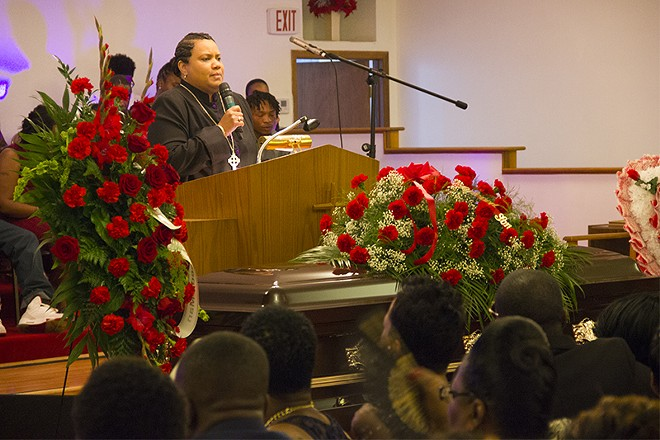 """""""He had a voice to the world,"""" said Pastor Gina Kelly during Crawford's eulogy. """"But his voice is still speaking through us."""" - PHOTO BY DANNY WICENTOWSKI"""