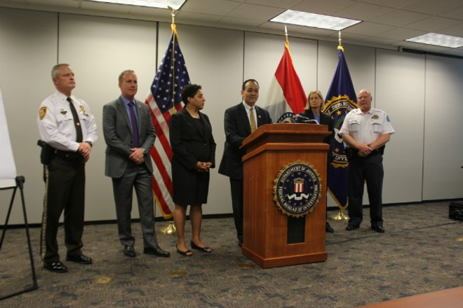 FBI Special Agent in Charge William Woods (center) and members of Mission SAVE announce indictments of alleged gang members. - PHOTO BY DOYLE MURPHY