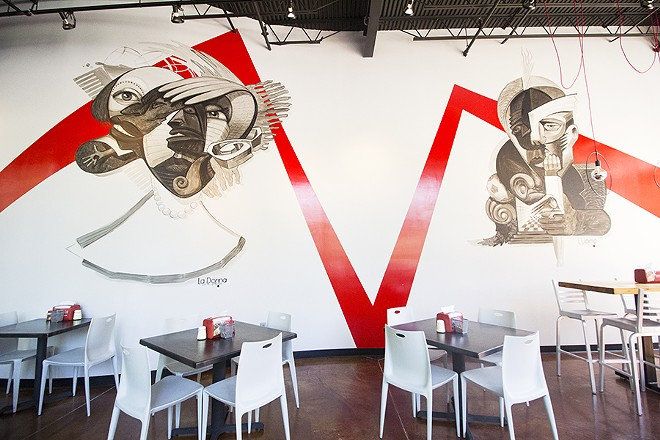 A striking black, white and red color scheme gives 'Zza's dining room a modern look. - PHOTO BY MABEL SUEN
