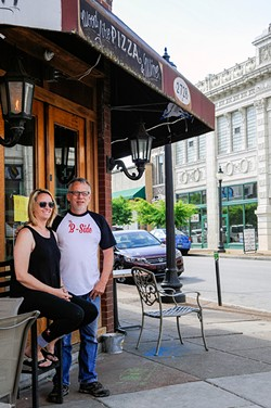 Beckie Lewis and Francis Rodriguez own two businesses on Cherokee. They're concerned about crime after an April 30 shootout. - PHOTO BY STEVE TRUESDELL