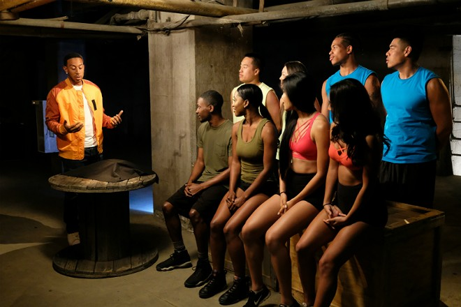 """Rapper/Actor Ludacris explains the challenges that St. Louis teammates Chris Peterson and Amanda Gavins (olive green shirts) and the other contestants will be attempting on """"Fear Factor."""" - SCOTT EVERETT WHITE/MTV/ENDEMOL SHINE"""