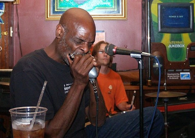 Eric McSpadden performing. The blues musician is known for his harmonica work. - PHOTO BY CHRISTINA RUTZ / FLICKR