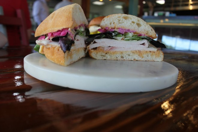 """The """"Tom Tom,"""" made with turkey, n'duja mayo, Swiss cheese, salad greens and pickled red onions. - CHERYL BAEHR"""