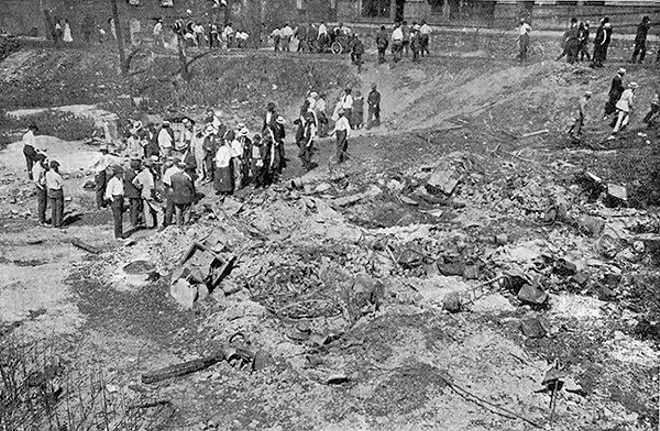 """Photos of the race riot's aftermath were published by the NAACP magazine The Crisis in September 1917. This photo's original caption read, """"Looking for bodies of victims. Six were found here."""" - PHOTO VIA THE CRISIS"""