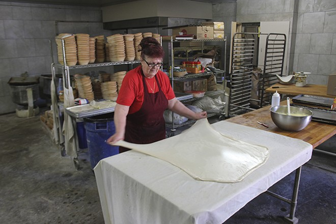Vahida Mahmutovic stretches the dough at Zlatno Zito Bakery and Deli. - DOYLE MURPHY
