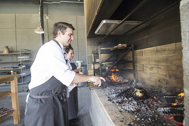 Chef Michael Gallina works the grill with pastry chef Summer Wright. - MABEL SUEN